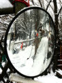 Rocky Brougham (cq) is reflected in a mirror as he clears snow from his Luckylure  Christmas tree...