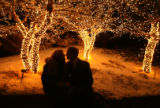 (DLM2015) -  Jennifer Menard, left, and Brad Hildebrand, both of Littleton, share a kiss under the...
