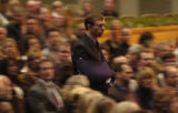 Frank Bingham walks past hundreds of mourners upon entering Colorado Community Church on...
