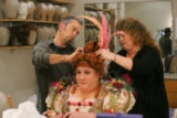 Costume designer Kevin Copenhaver, left, and wig master Diana Ben-Kiki put the final touches in...