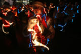 (DLM2081) -   With lights covering his instrument Bryce Leatherman, 15, warms up before performing...