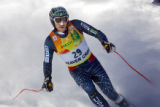 U.S. skier Bode Miller (#29) kicks up snow as he comes to a stop in the finish area after his...