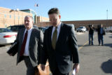 US Secret Service Special agent Lon Garner, leaves the Douglas County Courthouse with his attorney...