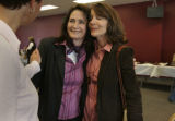 Julia Melendez (c) is hugged by Sarah O'Connor (cq) (r) with Denise Whaley (l) as they comfort...