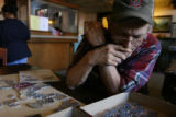 Randy Spangler, (cq), works the technical of a puzzle with rounded corners in the lobby of the...