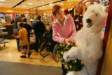 Retail consultant Susan Sisk (cq) sets up a polar bear at the entrance of the Museum Shop at the...