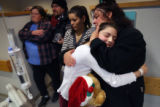 MJM211   Lacey Gonzalez, 15, is hugged by her mother, Edi Gonzalez (cq) after as Lacey cradles the...