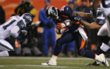 [JPM0151] In the first quarter, the Denver Broncos running back Mike Bell (20) lowers his head as...