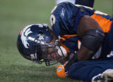 In the fourth quarter, the Denver Broncos Al Wilson (#56, LB) grimaces in pain on the field after...