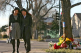 Samantha Nguyen, left, and her sister Nga Nguyen, walk away from a memorial for their brother Nhan...
