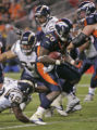 BG0520 In the second quarter, Denver Broncos Mike Bell scores the first of two touchdowns aginst...