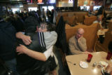 Bob Duran,(cq)  a patron since 1975 hugs waitress Nikki Rivera (cq) with tears in his eyes as 27...