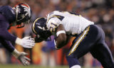 [RMN050] - In the first quarter, San Diego Chargers LaDainian Tomlinson (21) lowers his head into...