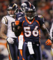 [RMN056] - In the first quarter, Denver Broncos linebacker Al Wilson reacts to tackling San Diego...