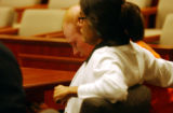 "(DENVER, Colo.,  Aug. 10, 2004) Robert ""Raffie"" Henderson sits next to his attorney Judy..."