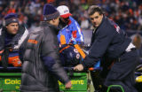 In the fourth quarter, the Denver Broncos Al Wilson (#56, LB) is carted off the field after being...