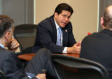 U.S. Attorney general Alberto Gonzales (center) during a meeting with the editorial board of the...