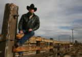 Gary Shoun, a Colorado brand inspector, stands at the Denver Stock Yards  at the National Western...