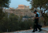 (ATHENS, GREEECE, AUGUST 10, 2004)   A security patrol with Athen's Municipal Police patrol a hill...