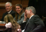 Judge Neil Gorsuch, right, reacts to comments made by speakers during his Investiture to the...