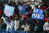 U.S. skiing fans cheer on U.S. skier Marco Sullivan as he makes his way down the course during the...