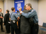 Colorado Springs Police Deputy Chief Dave Felice (cq, far right) is consoled by Colorado Springs...