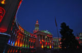 As dawn hits, the Denver City and County Building is lit during a test Tuesday morning of the...