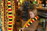 Jillian McAliney, 9 years old from Parker Colorado, plays with a colorful snake at the KIBONGI...