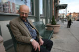 Dennis Tranberg, (cq), a new resident, sits outside to take advantage of the great weather....