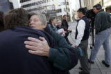Sister Ardeth Platte  (second from left) hugs supporter Gordon Luebs  (l)  from Denver, in front...