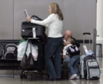 Georgia resident Krista Torrence  (l), desperately tries to call up her family's travel details on...