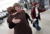 Anita Gilstrap  (m), from Thornton, cries and hugs her daughter Jessica Gelski , also from...