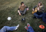 Jeremy Carlise  (upper l), from Denver, teaches a new guitar chord to Eleanor Evans  (r), also...