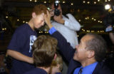 (DENVER, Colorado. August 10, 2004) Mike Miles tries to cheer up his son Nicholas,13 as he arrives...