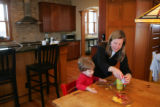 Buffy Naake (cq), helps her son, Wes, 2, with lunch in their Park Hill house.  Builder Steve Luber...