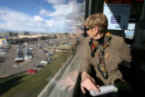 (DLM4371) -  Jan Montgomery, 68, rides a RTD light rail train through the Southeast Corridor to...