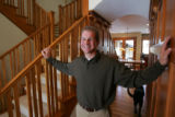 Builder Steve Luber (cq) of Denver, standing in the entry hall, created an updated Craftsman style...