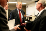 Governor-elect Bill Ritter shakes hands with Colorado State University president Larry Penley, cq,...