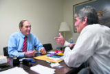 Reps. Joel Hefley, R-Colo., left, and Mark Udall, D-Colo., meet in the Rayburn House Office...