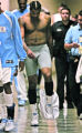 A disgruntled Carmelo Anthony kicks his shorts off after throwing his Jersey as he storms down the...