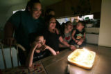 Olivia Manzanares (c)who has turned 10 listens as her mom Yvonne Caporal (cq) (l) cousin Eric...