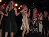 Karaoke Sponsor Barb Gallagher, center, belts out a tune along with her gal pals. (DAHLIA JEAN...