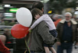 Balloons couldn't cheer up a worn out 4 year old Natalie Nevin as she and her father Chris Nevin...