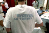 (DENVER, Colo., Aug. 10, 2004)   Shane Critz had to turn his political t-shirt inside out because...