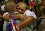 MJM147   Linda Cary (cq) hugs her son, Staff Sergeant, Joshua Marron after arriving with fellow...