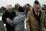 Francis Jampetero (cq), 88, (l) hugs Eddie Browning (cq), the wife of fellow survivor Bill...