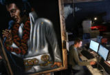 MJM686    A velvet Elvis portrait hangs in front of Bas Hamer (cq), right, as he works on the new...