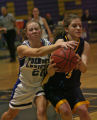 Colorado Springs Christian player LeeAnn Routt, right, battles for the ball with Denver Christian...
