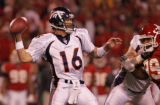 [JPM024] In the first quarter and with , Denver Broncos quarterback Jake Plummer (16) throws a...