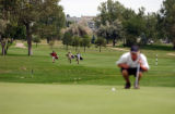 (AURORA, Colo., Aug. 25, 2004) Some unidentified high school student walk up the fairway at the...